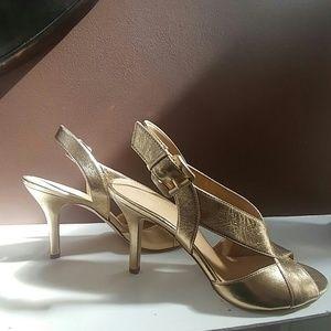 The cutest gold sling back sandal heels